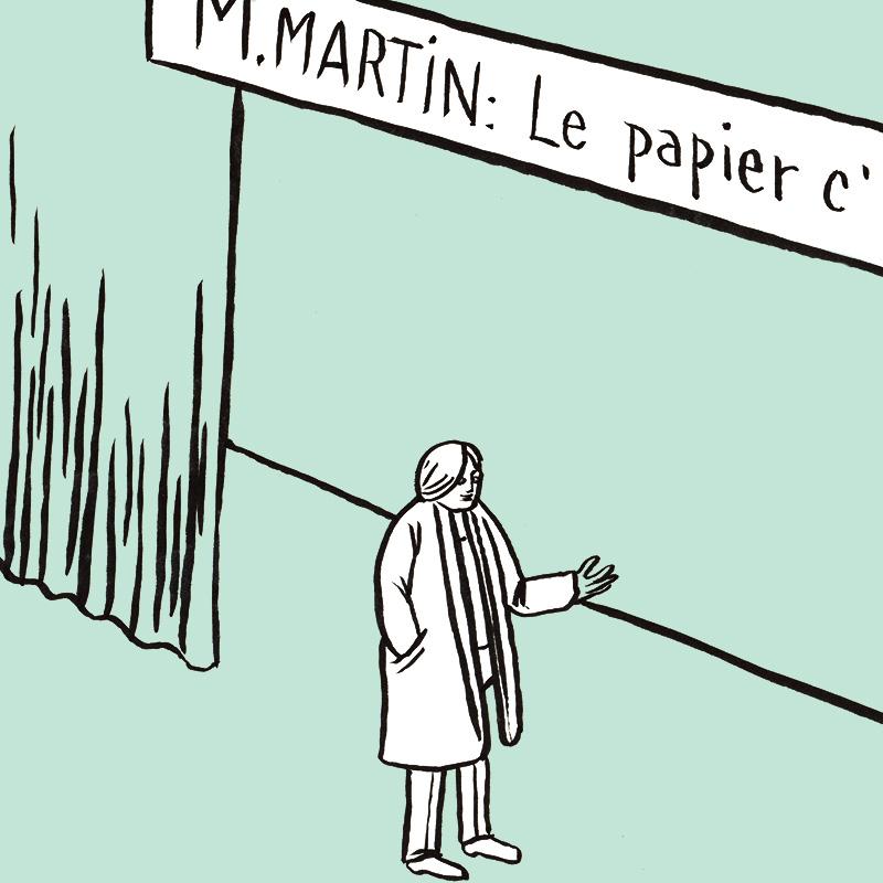 Le personnage en veste est sur scène, un bandeau de surtitrage est positionné au-dessus de lui avec le texte: «Le papier, c'est pour écrire».